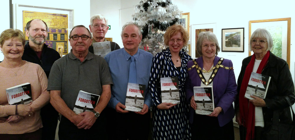 Photo call with VIPs and friends of  Forgotten  at the Pontypool Museum. From left, Cheryl Morgan, Robert Prior, David Prior, Ken Clark, Peter Garwood, Linda Hervieux, Torfaen Mayor Veronica Crick, Dot Jones.
