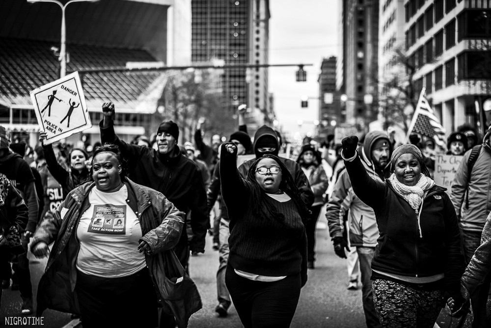 Alana Belle, middle, marching through downtown Cleveland
