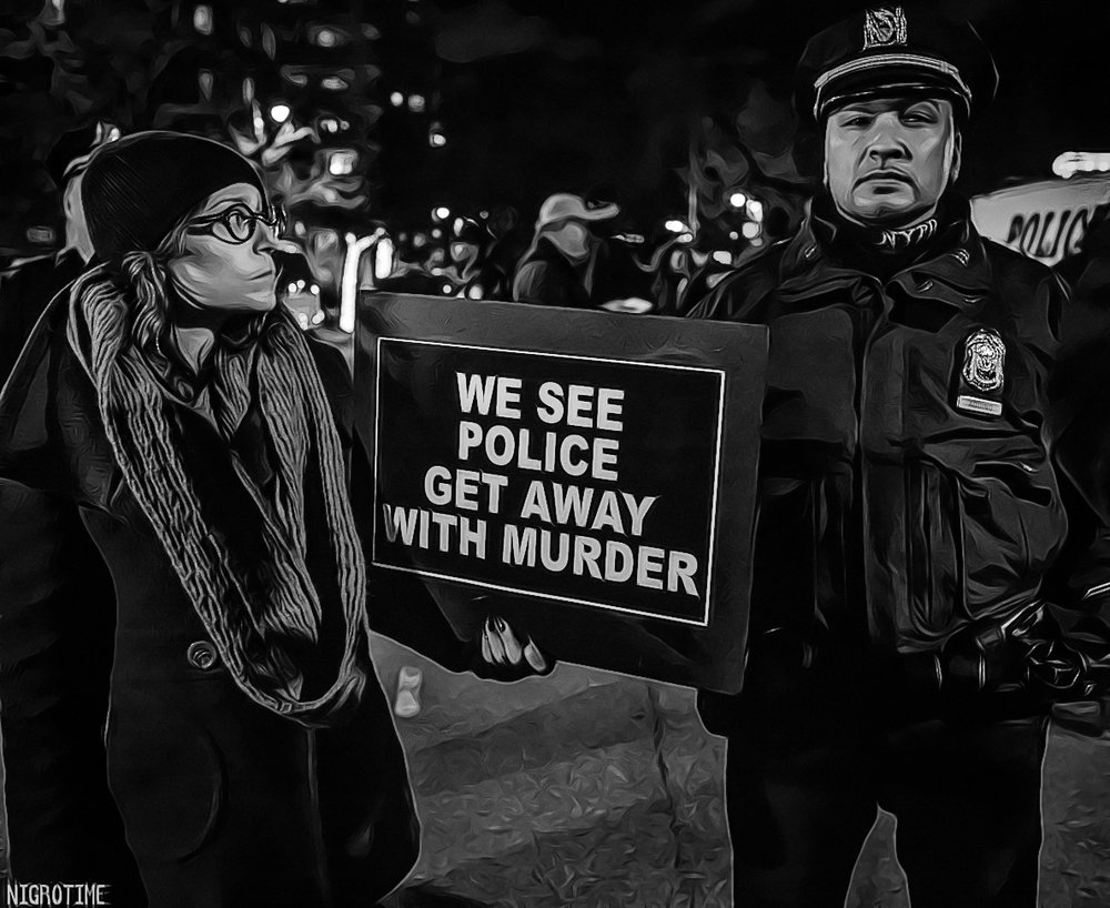 Activist Sarah Wellington of the activist/art collective         We Will Not Be Silent    , at an Eric Garner memorial, NYC 2015
