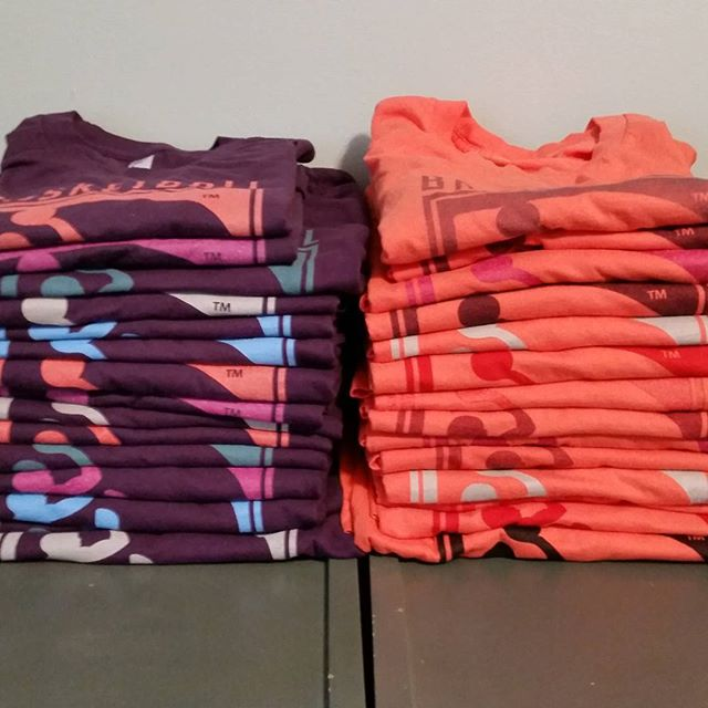 A quick shot of some coral and eggplant shirts for @basketballbiomechanics  Get hyped for more summer colors coming soon!