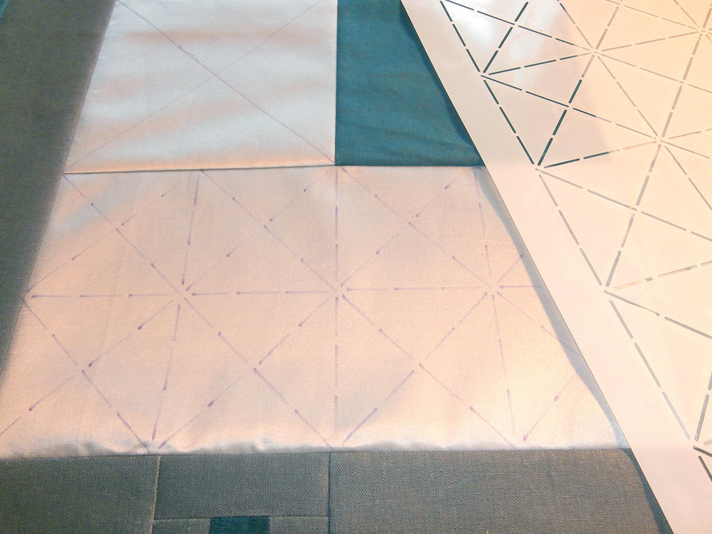 Making the basic design with her Crossed Squares stencil.