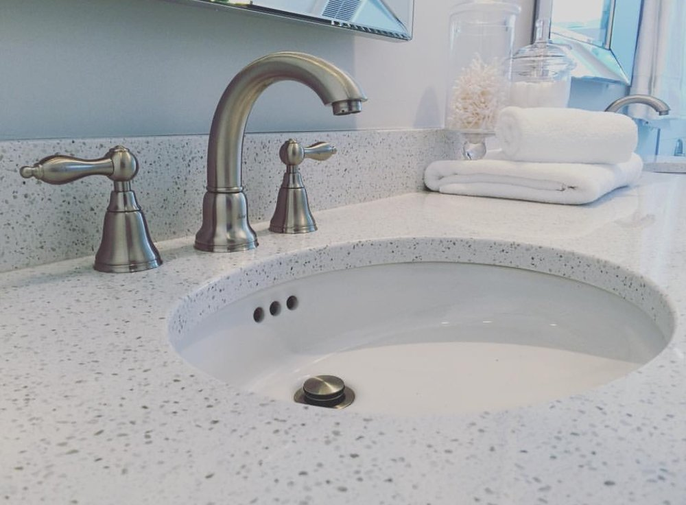 bathroom vanity with Hanstone quartz countertops and undermount white bathroom sink