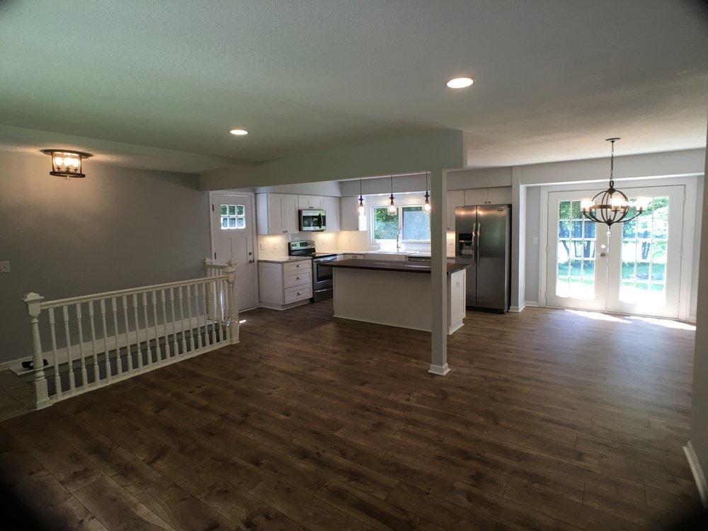 white kitchen with island. Riverbend oak Pergo flooring