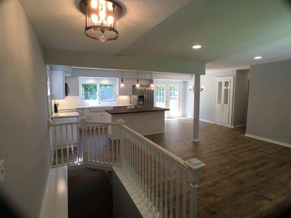 white railing, white kitchen, walnut butcher block countertop, white build-in cabinet