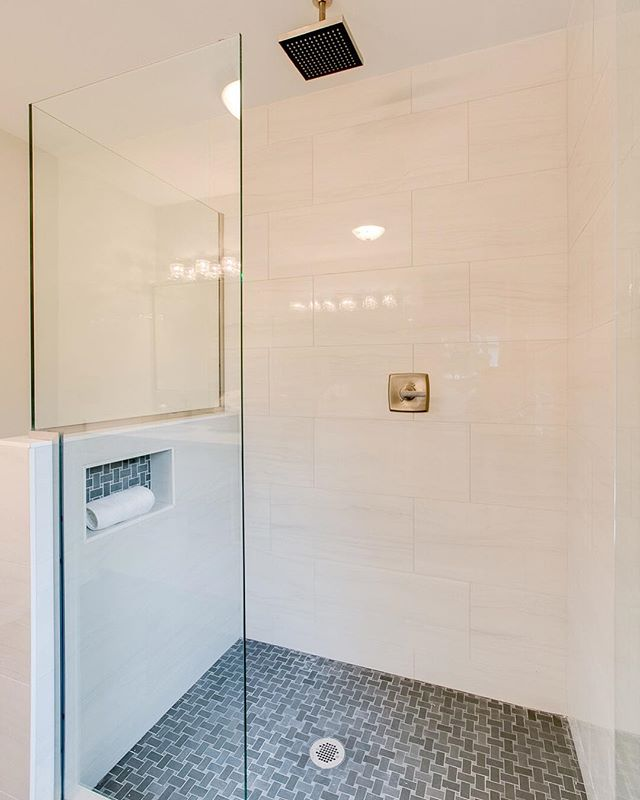 "Real talk: How do you feel about putting the same tile in your niche as you have on the shower floor? Our clients (and I) seem to do it often, then recently I heard from someone who thought it was the strangest thing - and I quote, ""I don't want to see my floor on the walls!"". So what do you think, 👍🏼 or 👎🏼 ?"