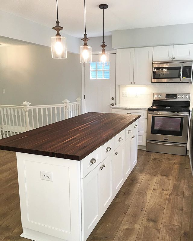 Happy Thursday! This morning as I was perusing some past remodel photos this one caught my eye .... definitely loving the warmth of this beautiful walnut butcher block countertop. Anyone else a butcher block fan? 🙋🏼⠀ ⠀ It also reminded me we are putting these into the butler's pantry of our new construction home in Minneapolis which got me super excited! If only I could fast forward to my favorite parts of every project.... ⠀ ⠀ If you want to learn more about this remodel or see the before and after for this project, head over to the website! Link in profile 👍🏼