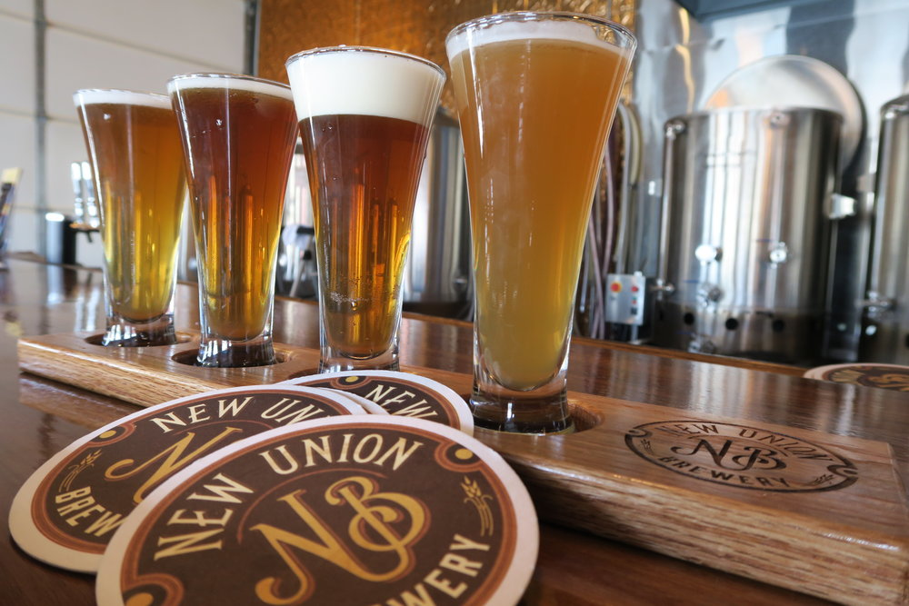 Sampling a flight of New Union's brews