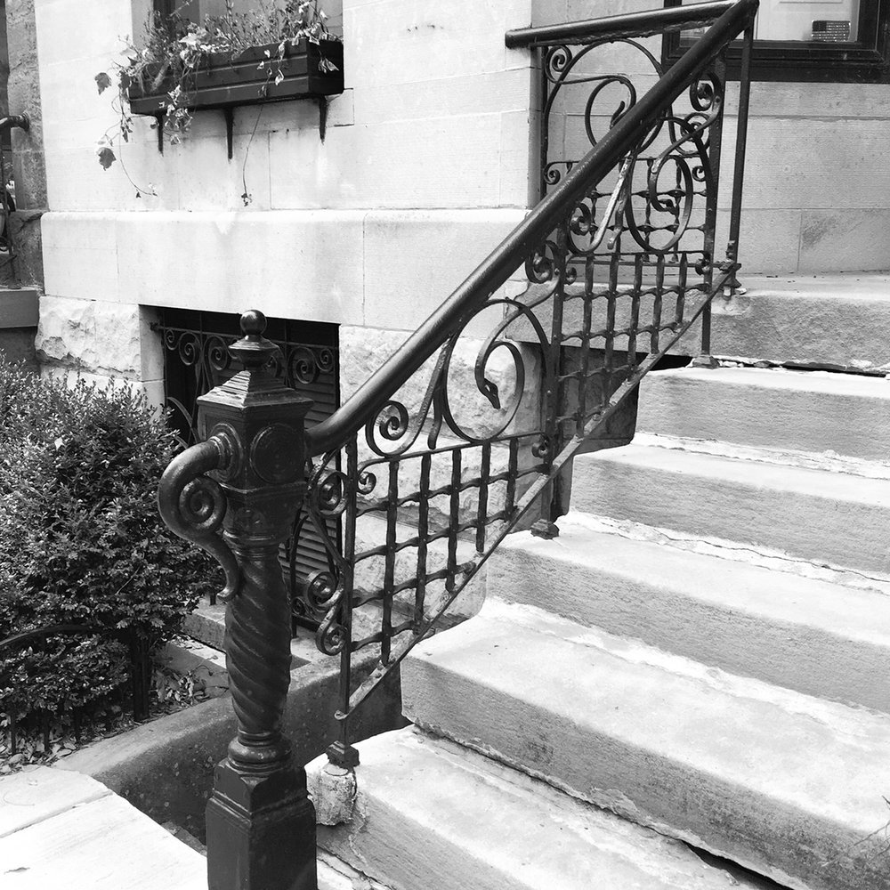 Wrought-iron handrail at front entry stoop
