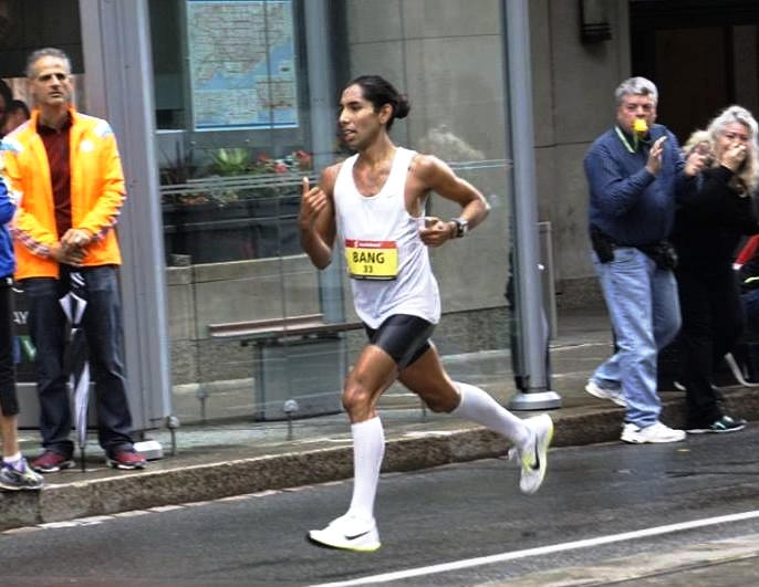 Thank you to Michael Lin for capturing this photo. It's a picture of me turning on Bay and Wellington and my parent's  cheering me on. My Dad is blowing a kazoo that he got on a tour in Philadelphia when we were there for my last Marathon. He brings it to every race so that I can hear him. My Mom ( as Mom's do) is crying.