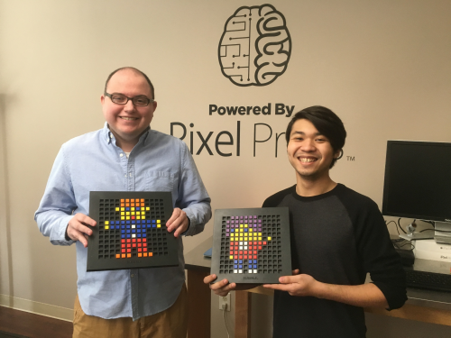 Phil Stortzum (left) and Richard Centeno (right) show off their Bloxels board creations.