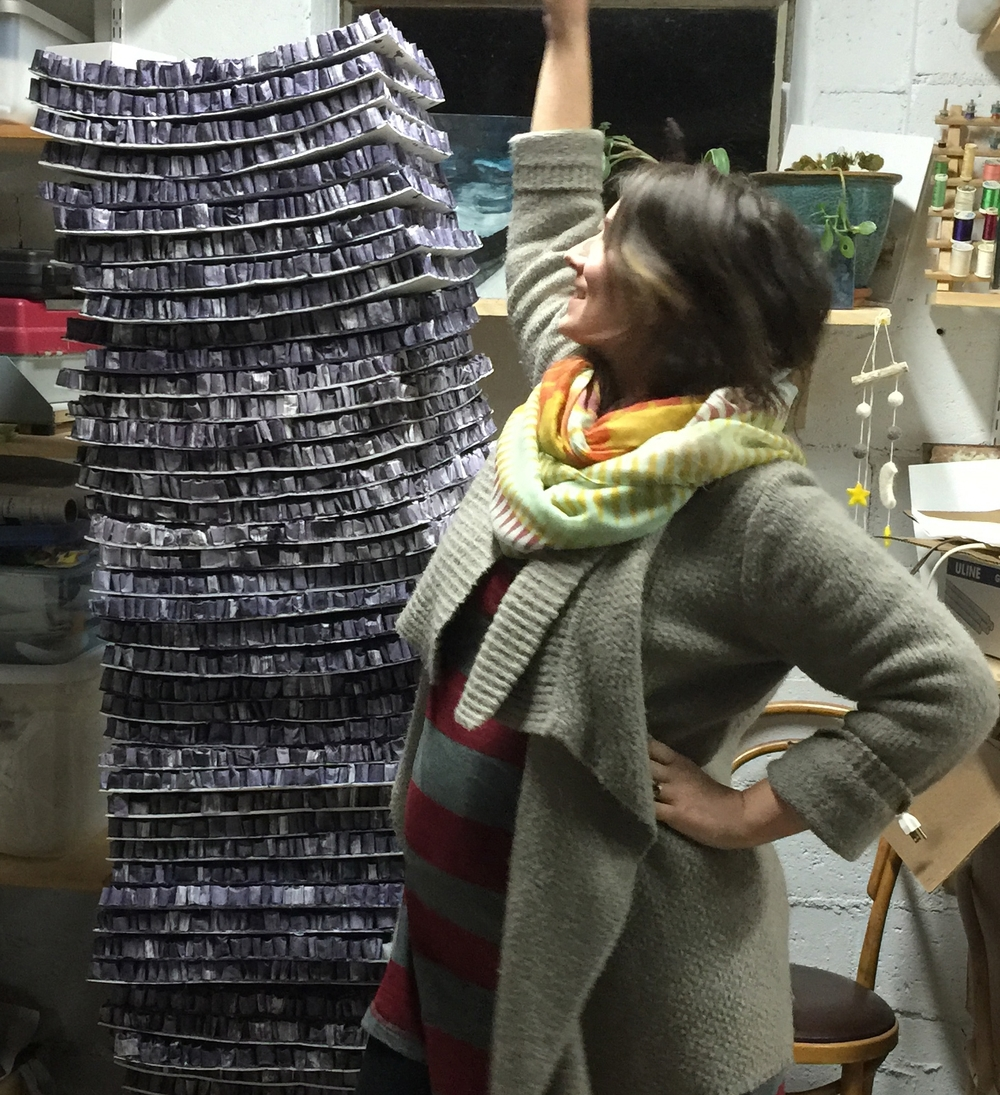 a VERY pregnant me with a stack of finished pieces for a big project earlier this year