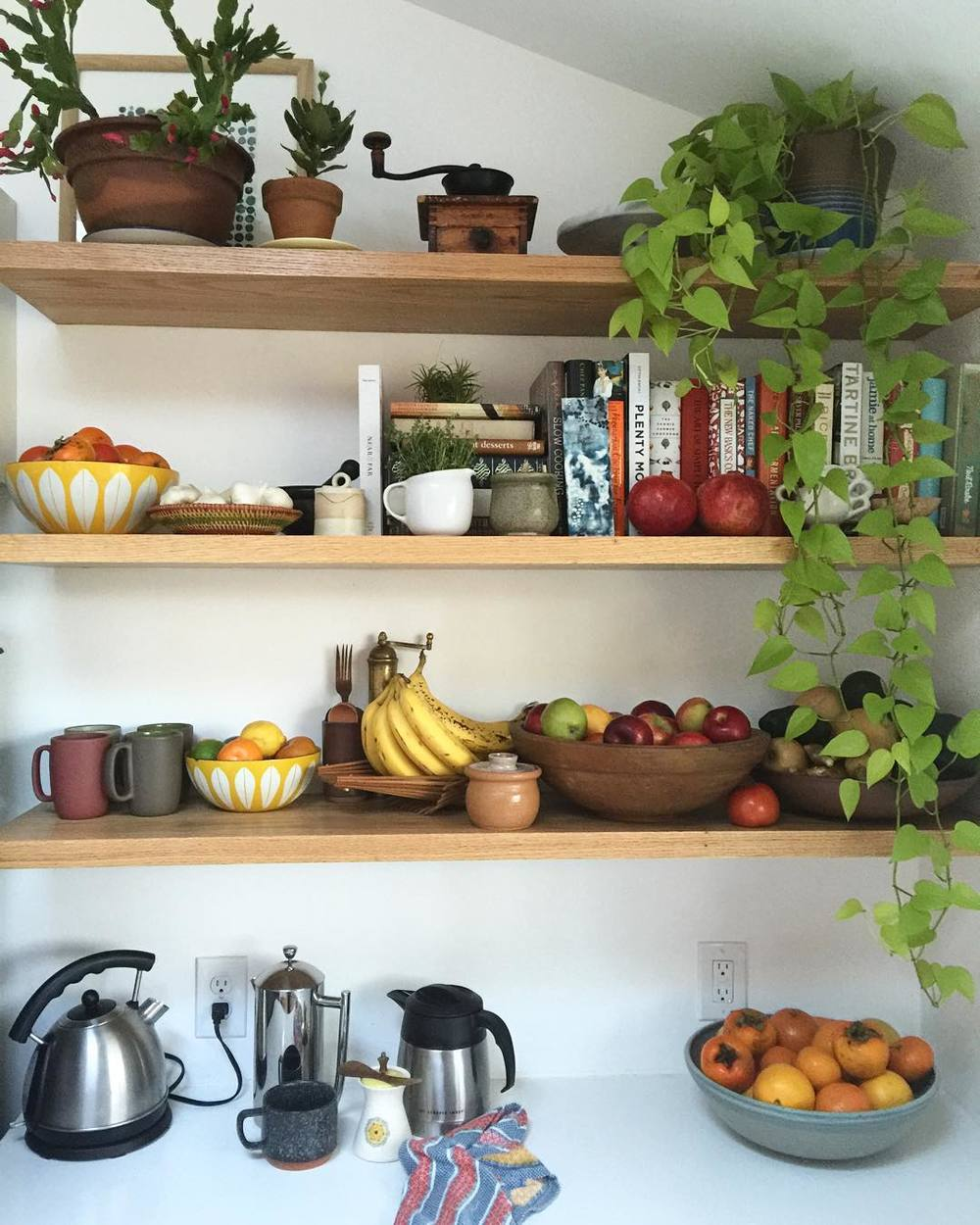 So many of my favorite finds are on display on the open shelves in our kitchen; ceramic bowls, canisters, and dishes, baskets, Catherine Holm bowls, wooden spoons.