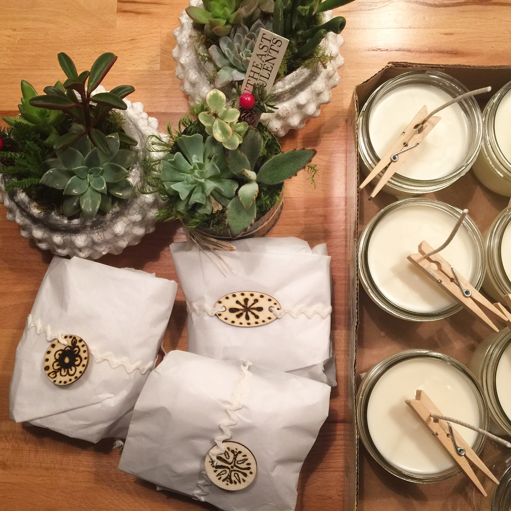 Succulents from a local spot, homemade cookies with woodburned tags, and homemade soy candles for teacher's gifts.