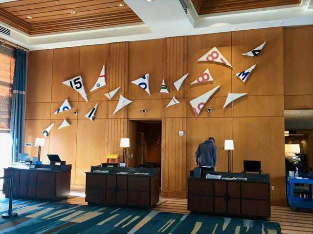 Emily Mann, Ink and Indigo, custom sail inspired wall installation for hotel lobby, wood, foam, repurposed sails.jpg
