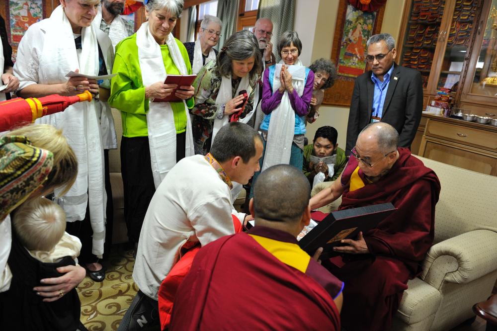 His Holiness the Dalai Lama receiving the first copy of Celestial Portfolio