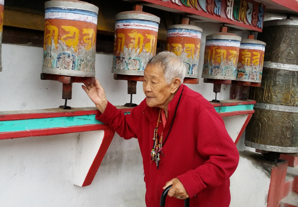 Yogini Tsarak Sonam Lhendu spinning prayer wheels at Zangdok Palri Monastery, 2015