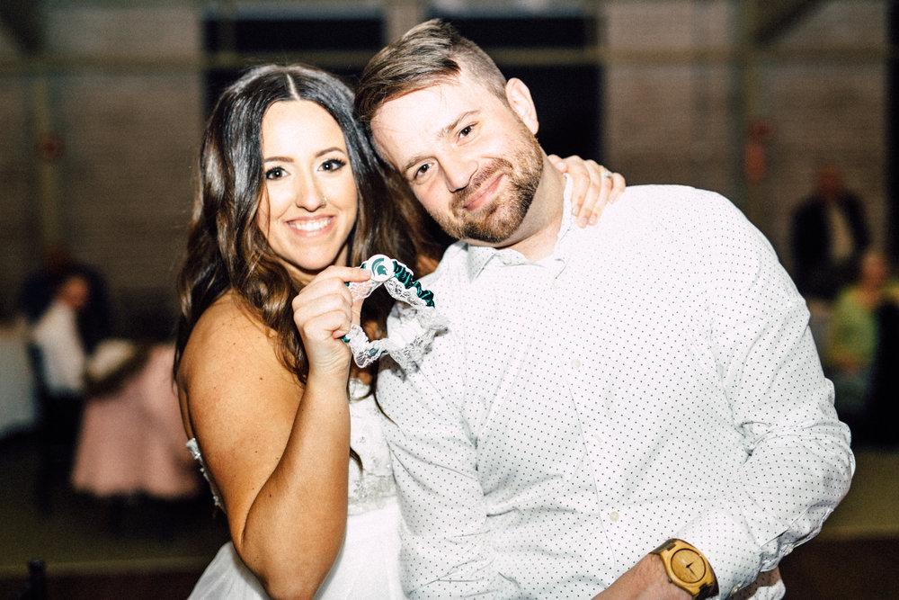 Kayla-Joel-Reception-Michigan-Wedding-Photographer-231.jpg