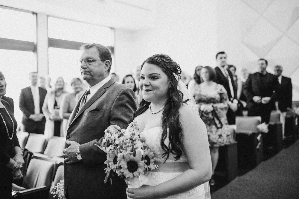 Katie-Nick-Ceremony-Grand-Rapids-Wedding-Photographer-57.jpg