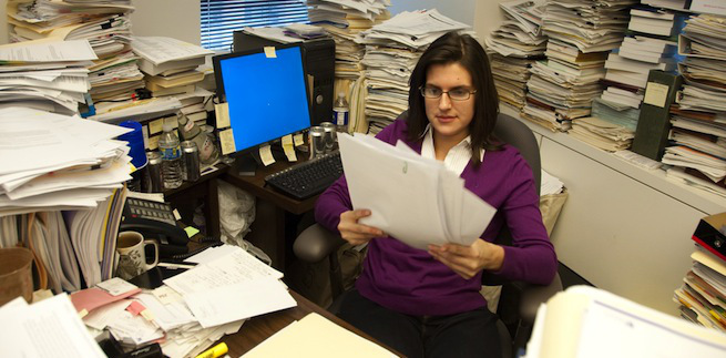 cluttered office paper files