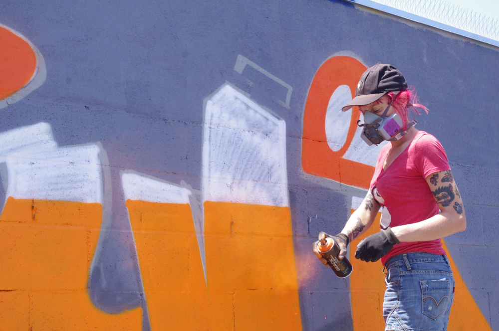 Australian artist Myla working on a wall in Costa Mesa | Photo by Linda Domingo