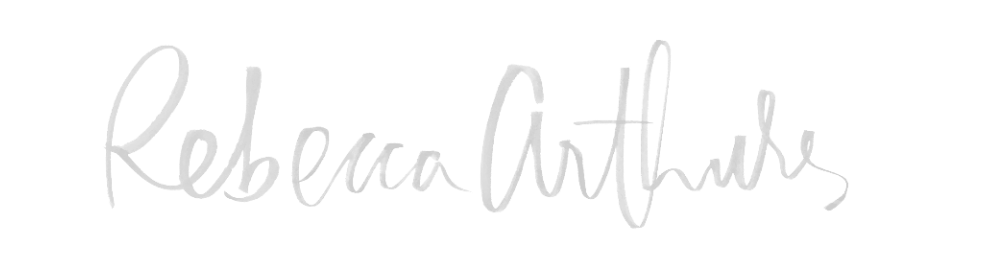 http://rebeccaarthursblog.com/  I love how this logo looks like an autograph more than just a professional caligrapher writing it out. I think it adds more of a personal touch to the website.