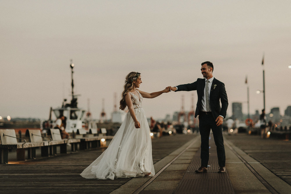 A couple dancing on the pier at the Pipe Shop in North Vancouver.