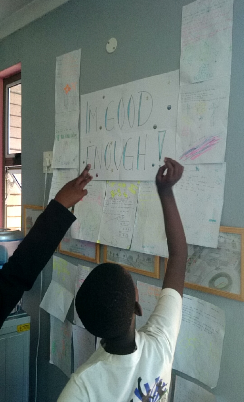 A group presenting their work for the other youths