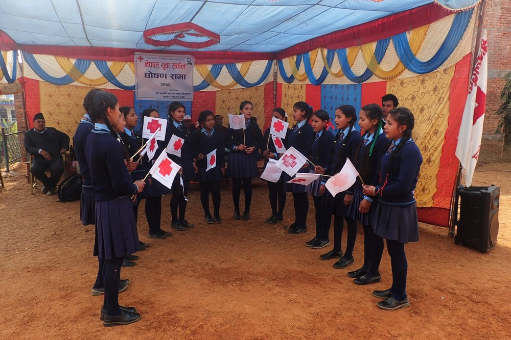 Red Cross Junior Volunteers singing a song about the seven principles