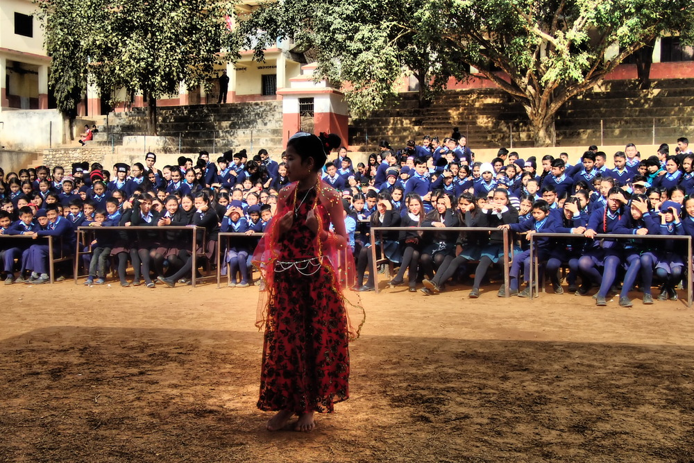 A young girl performing a cultural dance