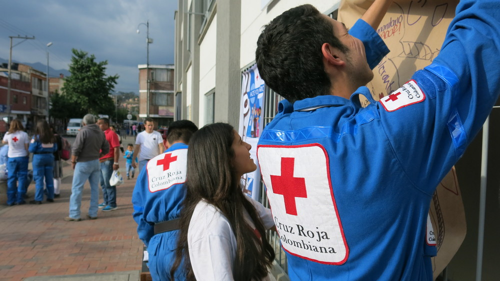 Preparing Our Red Cross stand outside the Zipaquirá Red Cross office