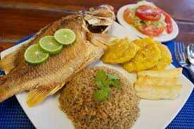 Classic fried fish, served with coconut rice and patacones (chips of plantain)