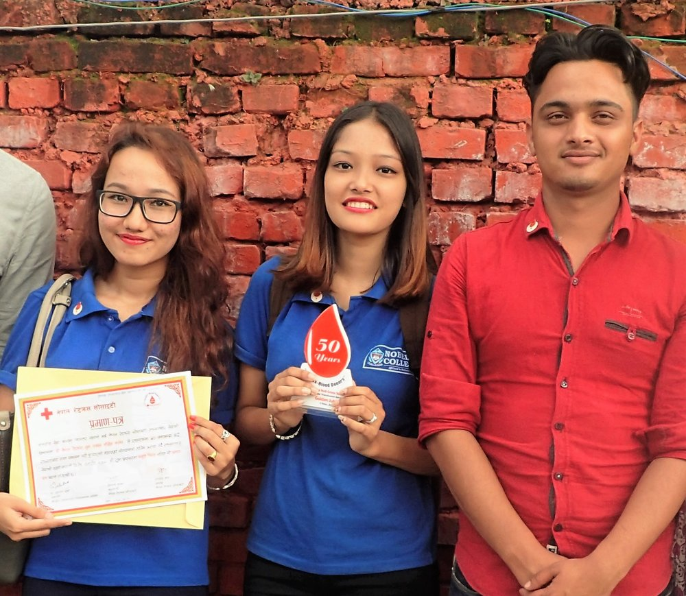 From left: Binika Shvestha, Kriti Shvestha and Sagar Pandey from Nobel College in Kathmandu participating at a Blood donation Recognition in Kathmandu.