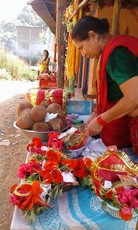Flowers, Tika, necklaces, coconut and incense bought before entering the Chabdi Temple. Photo by Ola Opdal