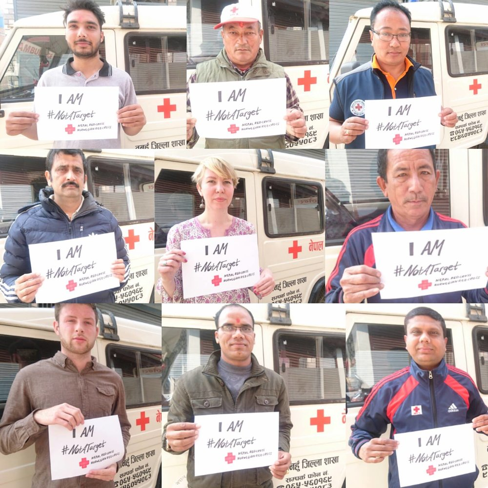 Staff of Tanahun Red Cross stands in solidarity showing that Aid workers are not targets. Aid workers are there to help people in need and does not take sides in conflict.