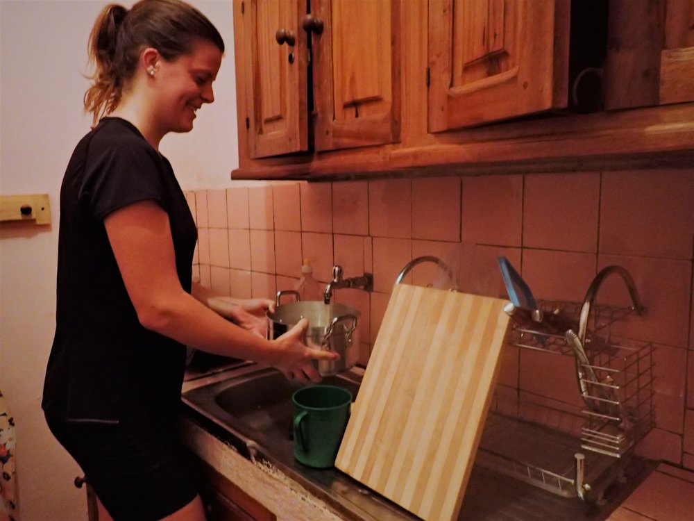 Kristina is stocking water at home