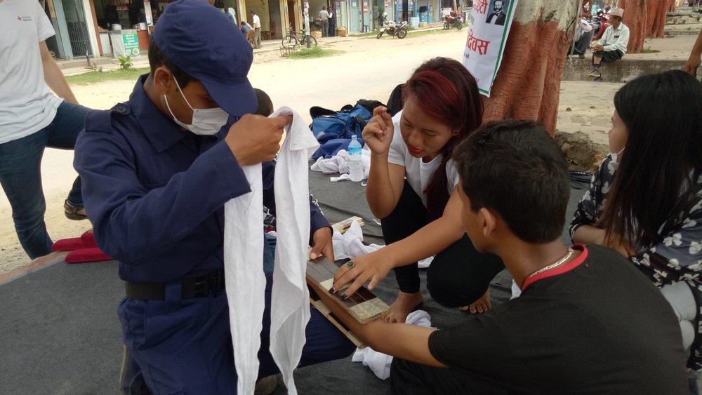 Locals practising first aid