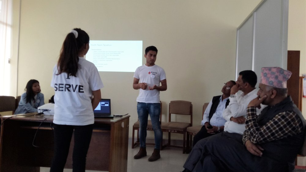 Youth volunteers presenting their work to Kaski District Chapter