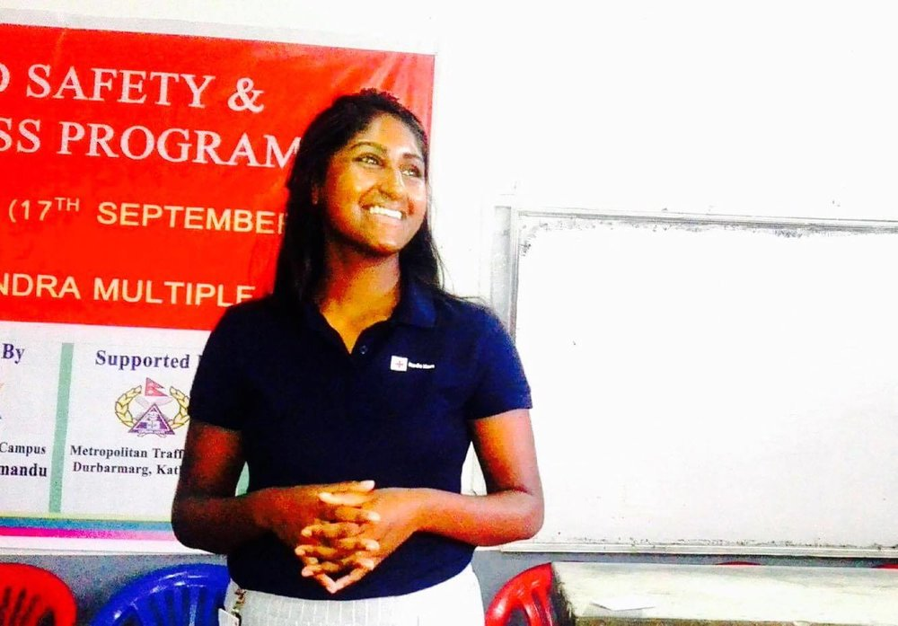 Photo by: Muna Shrestha   Thanuya helding a speech for Tri-Chandra Red Cross Youth on motivation.