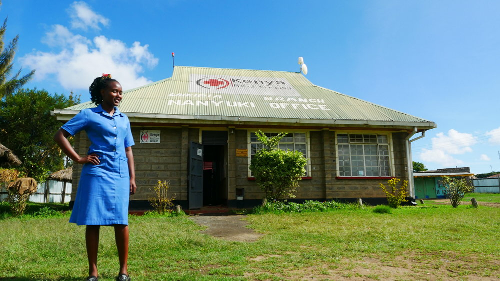Student of Health Education and Promotion, Ann Nyambura Mwangi, in front of the KRCS Laikipia Branch office in Nanyuki. Photo: Elfi Thrane Bemelmans