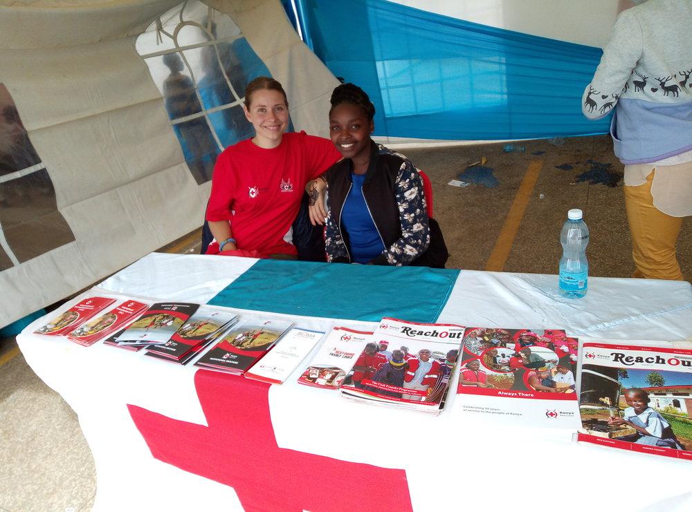 Youth Delegate Elfi and KRCS volunteer Irene in KRCS's tent at the Nanyuki World AIDS Day event. Photo: KRCS volunteer, Lydiah Bosibori Nyantika