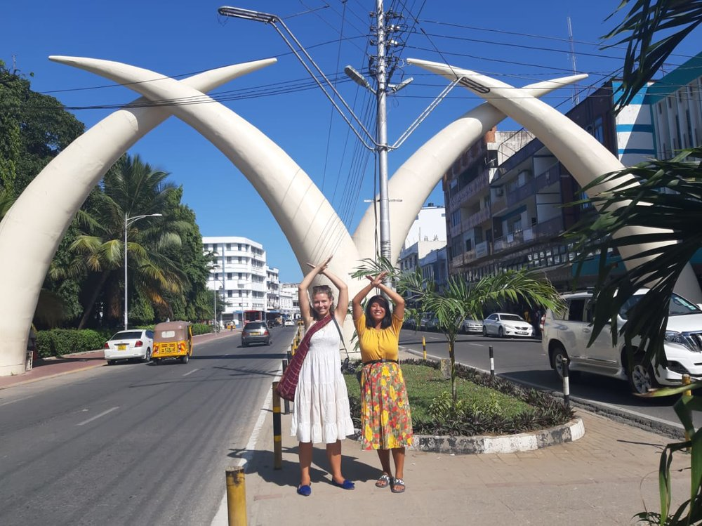 Elfi and her friend visiting from Norway, Mina in front of the Ivory Tusks of Mombasa. Photo: Fayaz Iqbal Hassan.