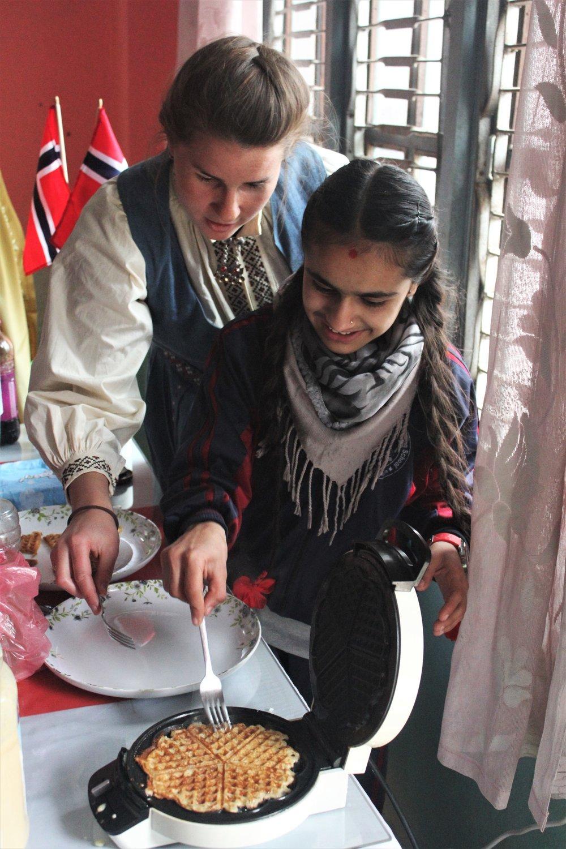 Svanhild and Rachana baking waffles  Photo: Emma Carlson