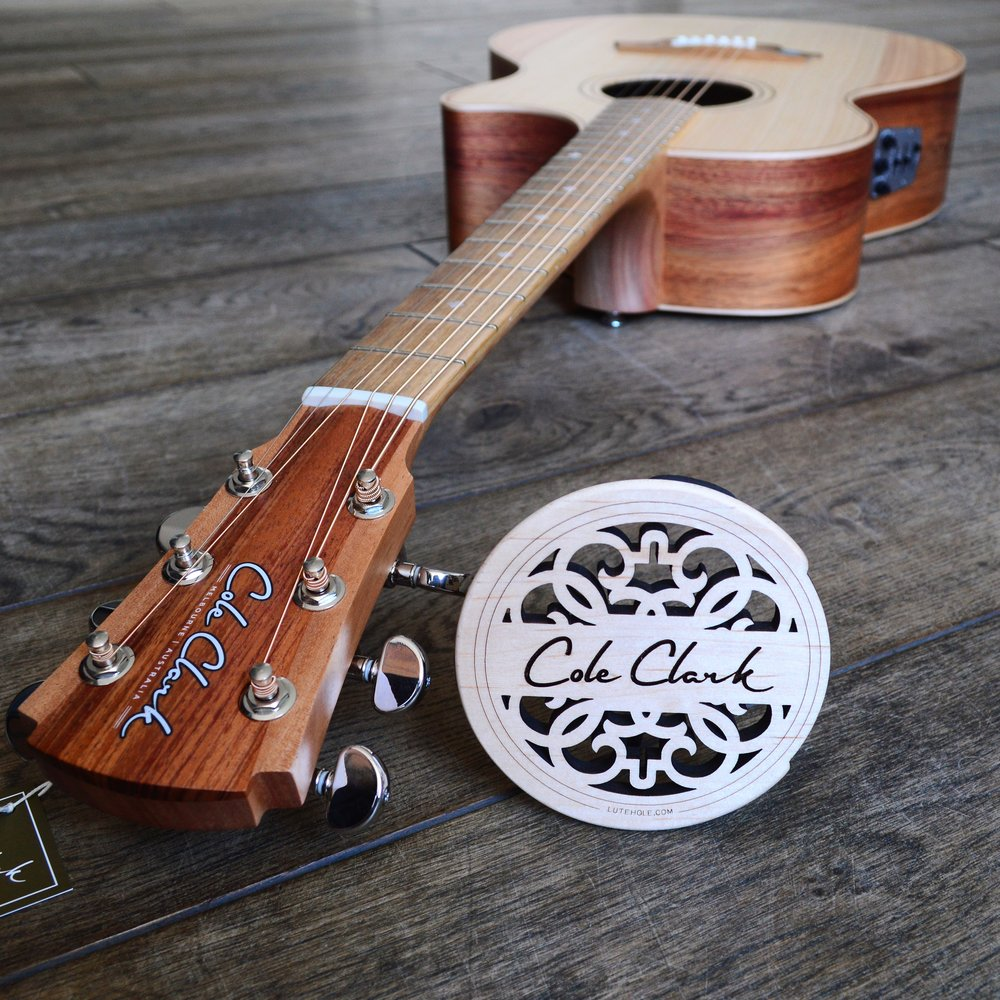 Cole Clark Maple Sound Hole Cover next to AN2EC-BB-AE