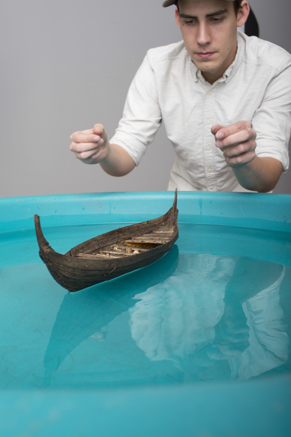 First we ordered a boat kit from England, assembled it, aged it, then photographed it in a baby pool in studio.