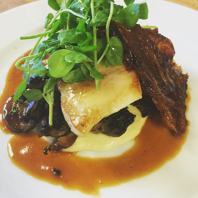 Peek under the pea shoots: layers of flavor in every dish.   Photo cred: Dylan Allwood