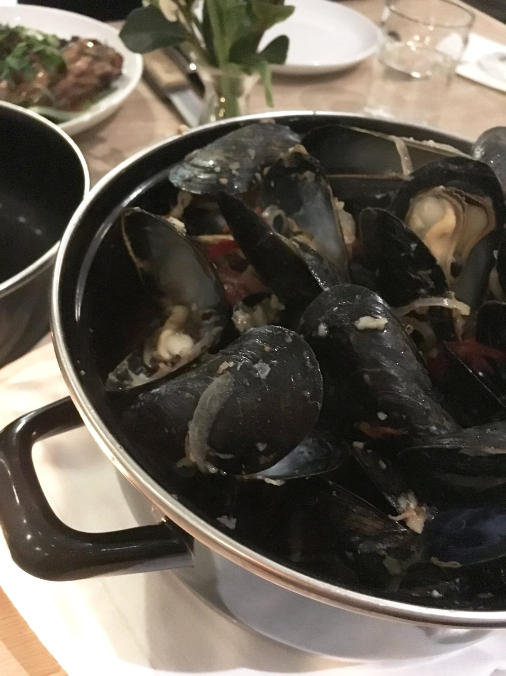 The house mussels are served with killer fries and some spice.