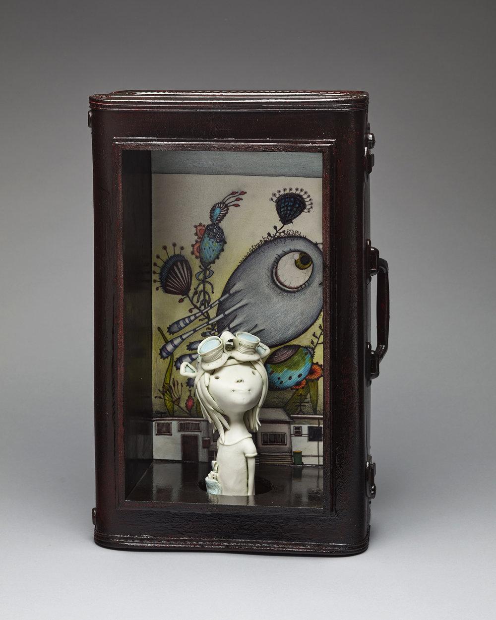 'Heidi's bigger-on-the-inside suitcase'   W 37cm x H 57cm x D 20cm   Porcelain, found object 2017