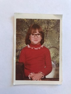 This is me at age 8. I was super into ice skating and my hero was the figure skater Dorothy Hammill so I had her haircut.
