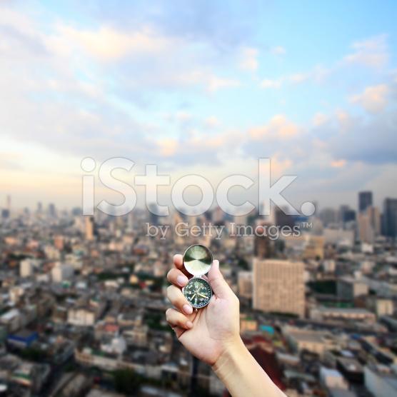 stock-photo-47195940-hand-holding-the-compass.jpg