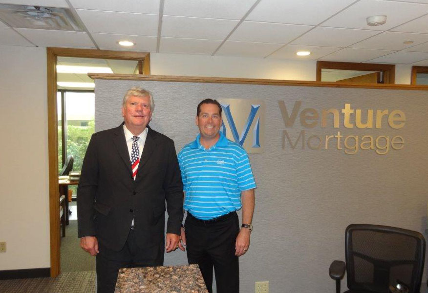 Venture Mortgage President and CEO Kip Dunkelberger with Dr. Ted C. Jones.